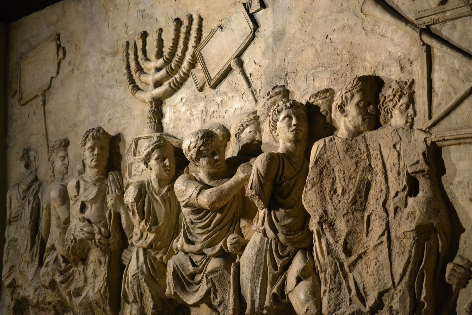 Carving on Arch of Titus depicting the taking of the Menorah from the Jewish Temple in 70 AD
