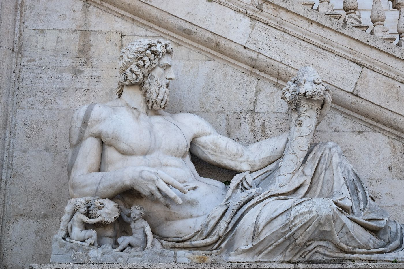 Ancient marble statue in Rome, Italy of Romulus and Remus being protected by Roman God